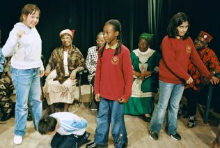 African elders from Ajoda group perform with children from Nightingale School, Woolwich, London