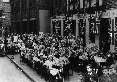 Victory party outside the Public House, Long Lane, Bermondsey.