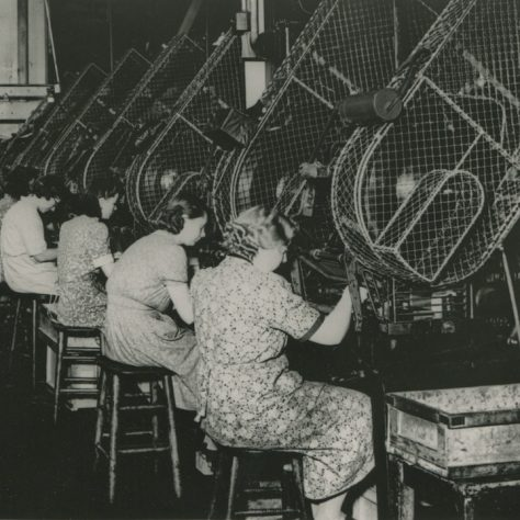 Women engaged in making parts for telephones